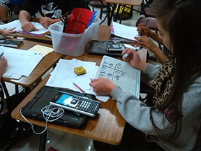 Old meets new: tablets and high-tech calculators are used concurrently with pencils and white boards.