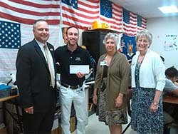Borenstein with LHS Principal Jeff Kajs, LEF Executive Director Connie Pelphrey and LEF Board Member Pam Nelson