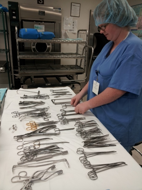 A student in the FoF Project Search program prepares surgical supplies at Medical Center of Lewisville.
