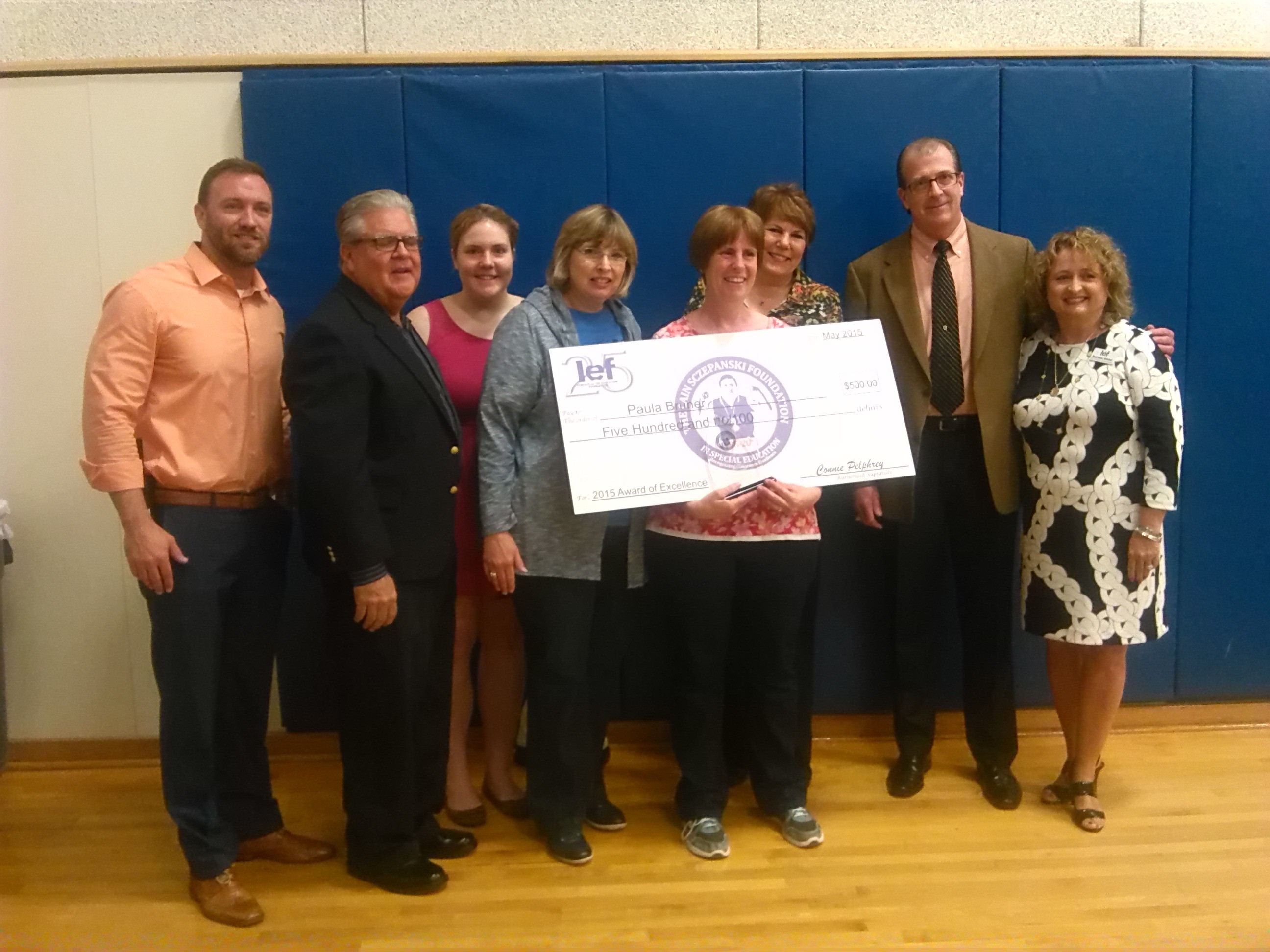The Sczepanski family presents the Cain Sczepanski Award for Excellence in Special Education to Paula Bruner at Forestwood Middle School