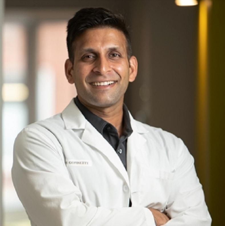 Chicago dentist Dr. Krishna Gopisetty explaining dental crown options at Wicker Park Dental Group