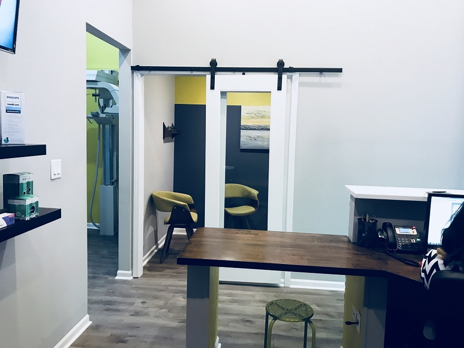 Digital X ray and consultation room view from the waiting area at Chicago dentist Wicker Park Dental Group